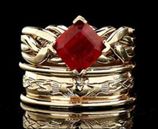 Cambridge puzzle ring with 2CT ruby and claddagh band with heavy trim