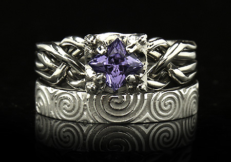 Celtic-inspired tanzanite puzzle engagement ring with Celtic Newgrange spirals band