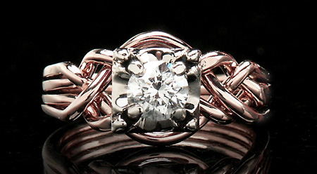 14K rose gold Guinevere puzzle engagement ring with 1/2CT round diamond and 14K white gold setting.