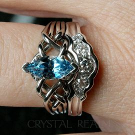 Marquise aquamarine four piece puzzle ring with diamond shadow band