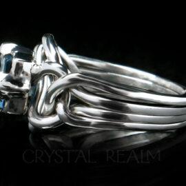 Side view of platinum aquamarine engagement puzzle ring