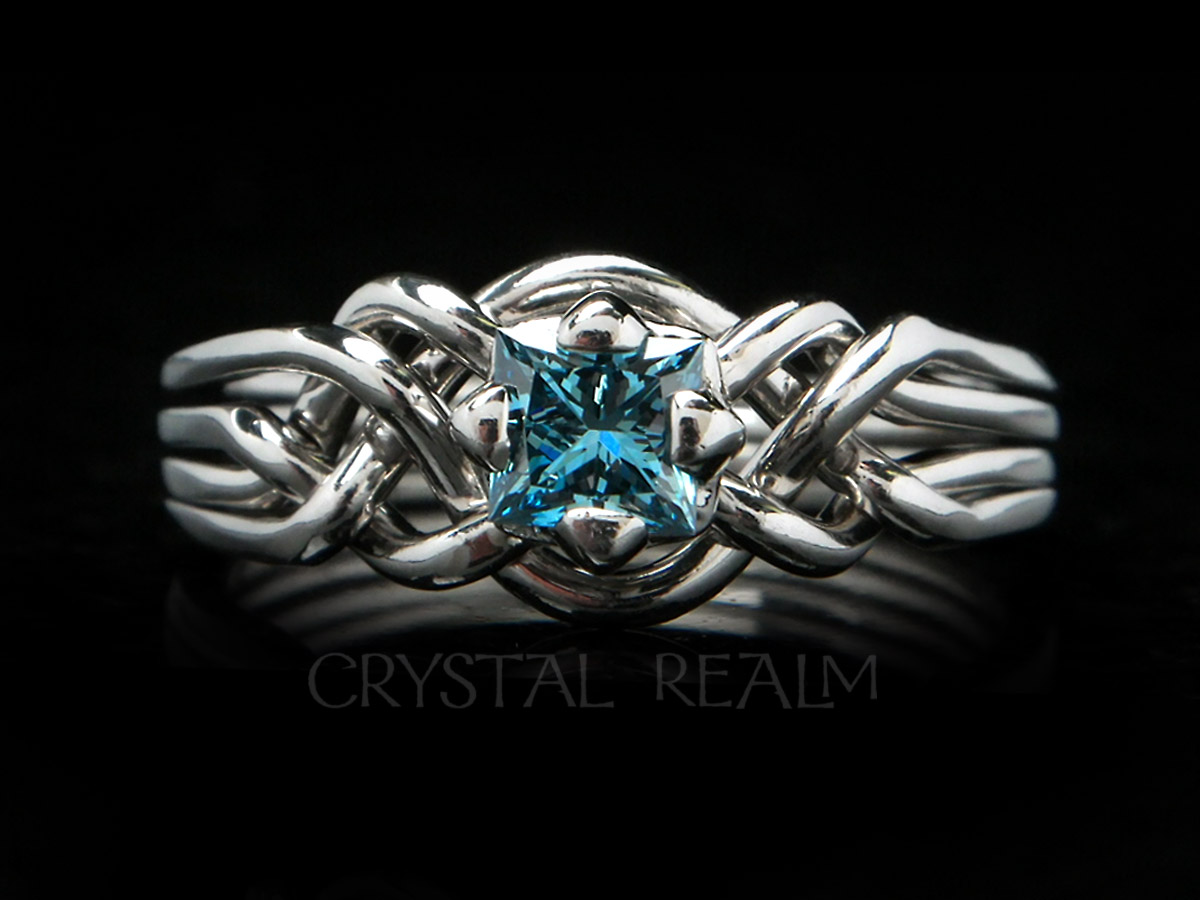 Four piece puzzle ring with princess-cut blue diamond