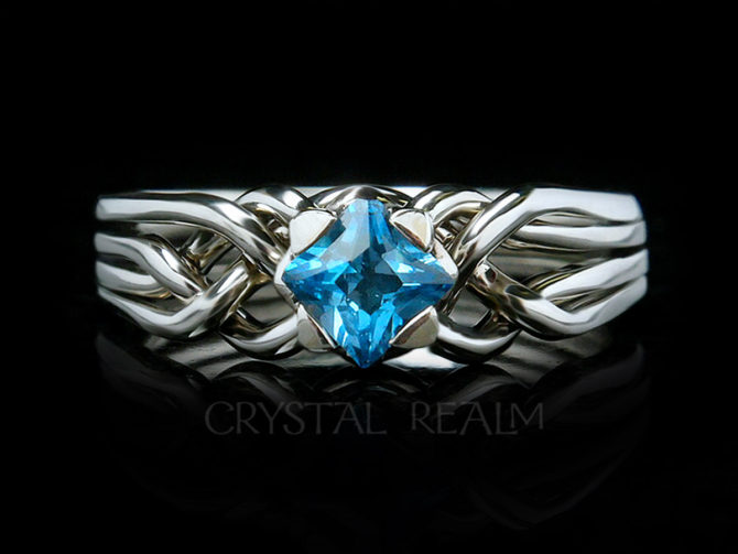 4 piece puzzle ring with princess cut blue topaz and palladium with a medium low setting