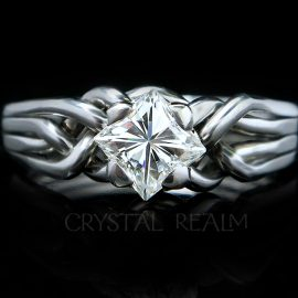 four band puzzle ring with princess diamond in platinum