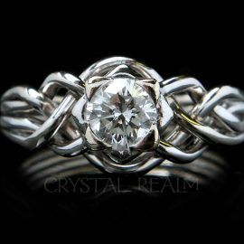 4 piece puzzle ring with round brilliant diamond and open weave