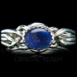 Our Avon Oval four-band puzzle ring bears a beautiful Lapis Lazuli stone from Afghanistan.