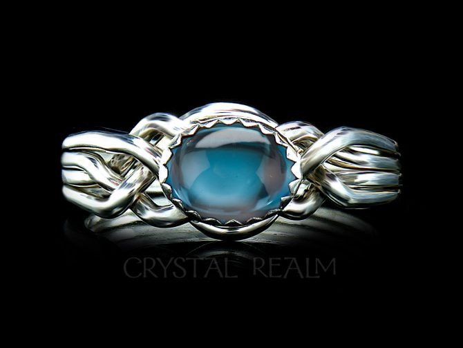 Avon Oval Four-Band Puzzle Ring with London Blue Topaz