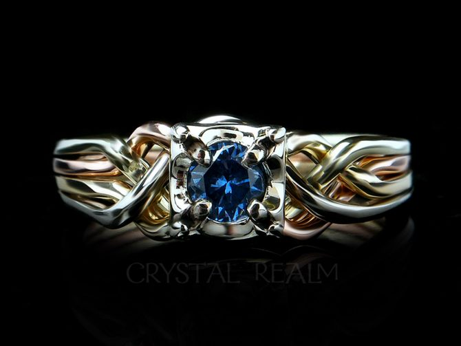 4 band puzzle ring with round lab created blue zircon and bands of four colors 14k gold