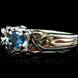 Guinevere four piece puzzle ring with round lab created blue zircon