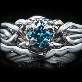 One-half carat blue diamond four band puzzle ring in Guinevere style mated with a 1.7mm shadow band