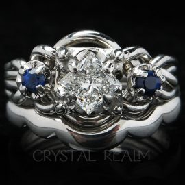 guinevere royale puzzle engagement ring with center diamond and sapphire accents with shadow band