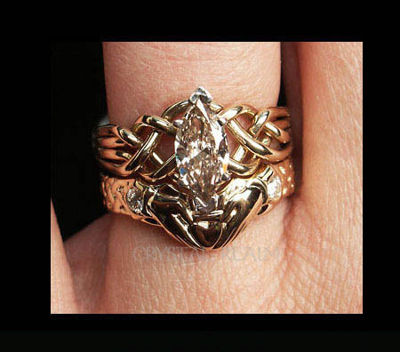 Marquise diamond puzzle ring with one carat diamond and claddagh shadow band set with two 6-point round diamonds
