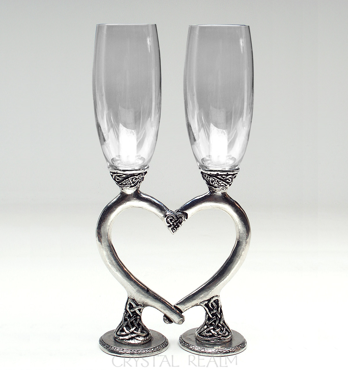 Clear toasting flutes with Celtic heart stems