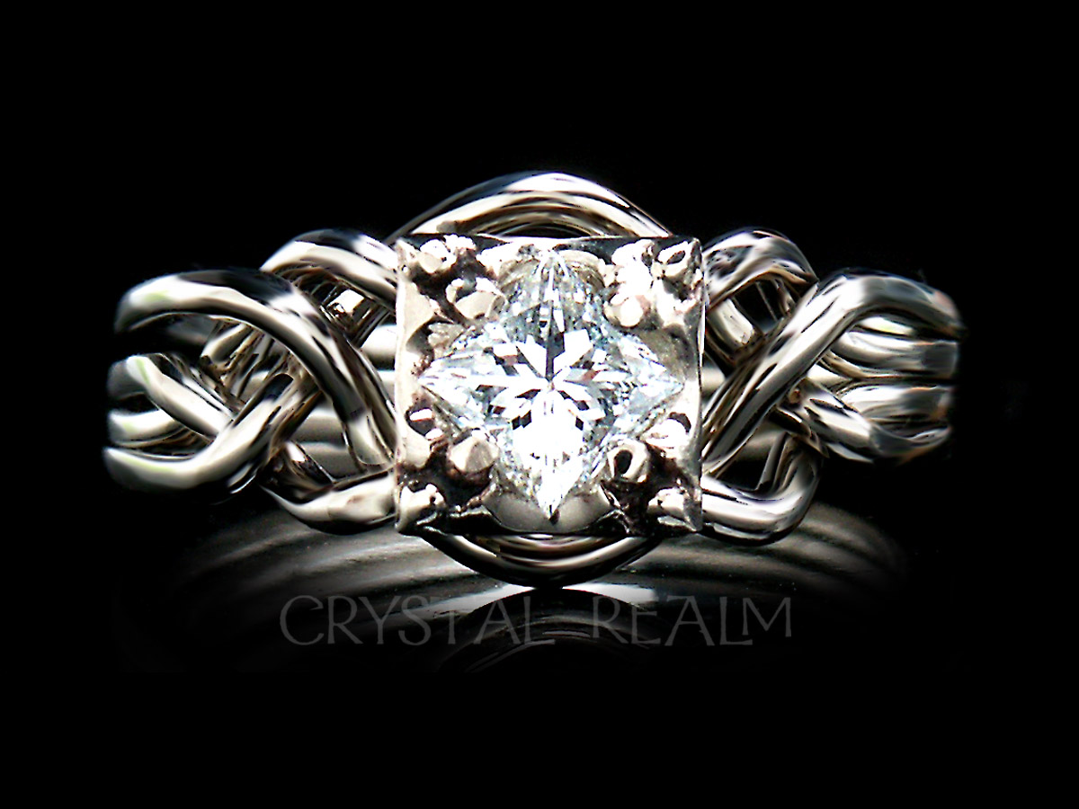 Guinevere 4 piece puzzle ring with a princess cut diamond