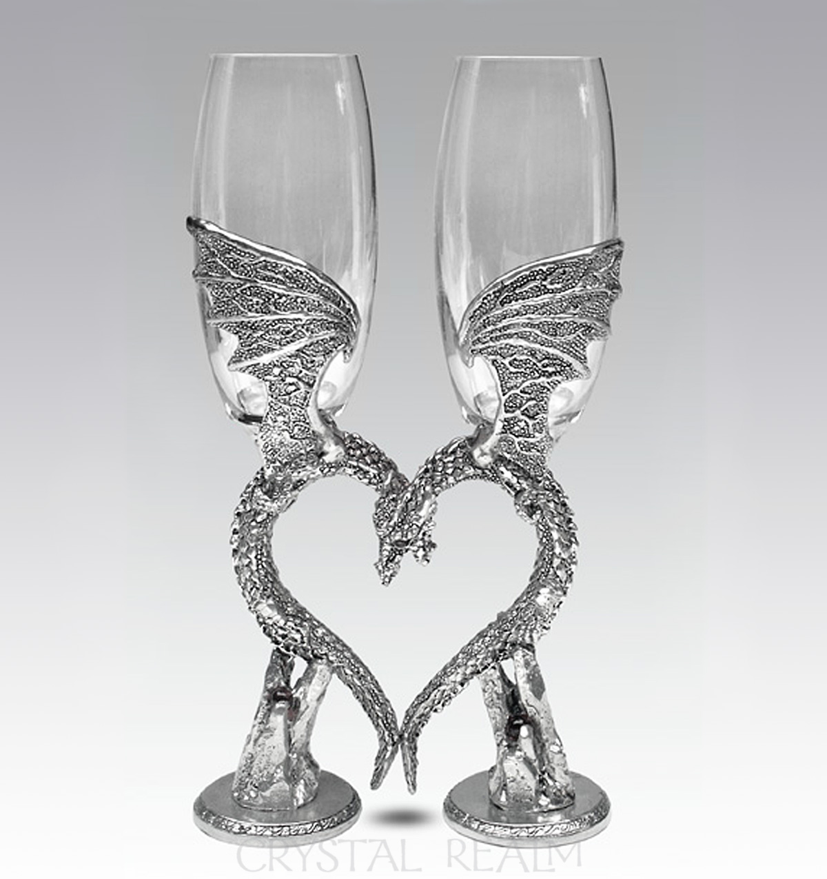 Clear toasting flutes with dragon wing heart stems