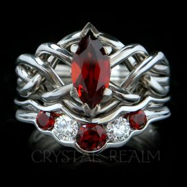 Four piece puzzle ring bridal set with one carat marquise garnet and wedding ring with garnets and diamonds