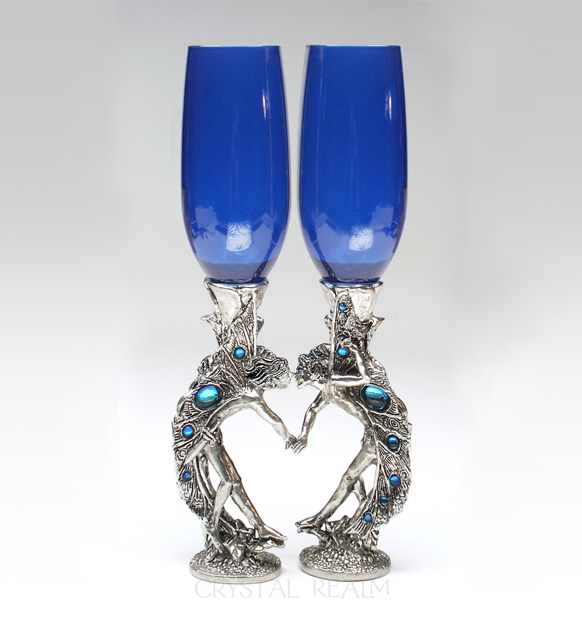 Girl-boy blue champagne glasses with fairies in a heart shape