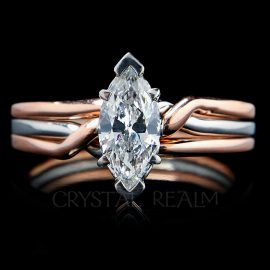 Marquise diamond puzzle ring on trinity puzzle ring