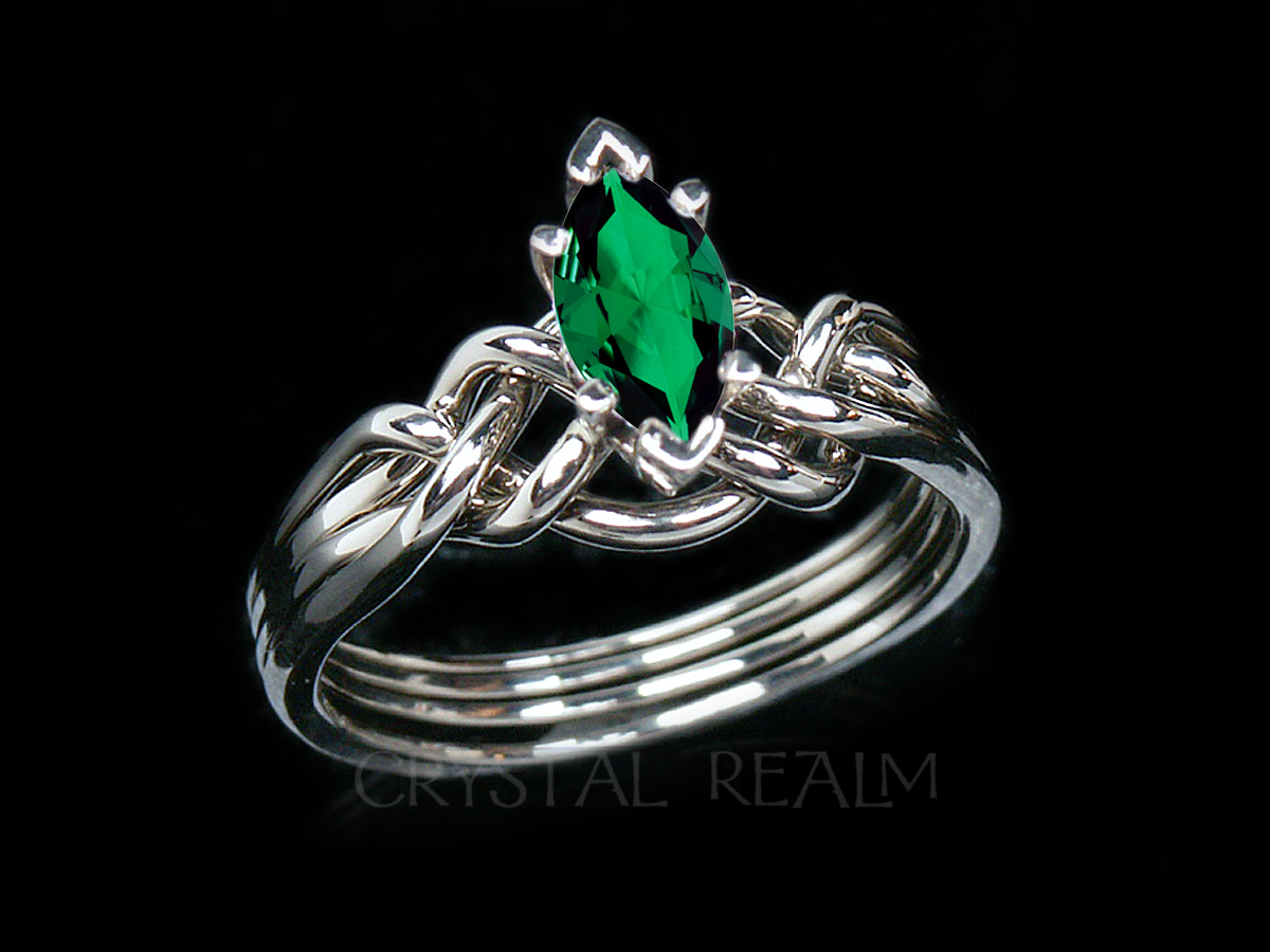 4 piece puzzle ring with a marquise rainforest topaz