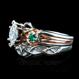 marquise engagement ring with diamond and emeralds with Celtic wedding band