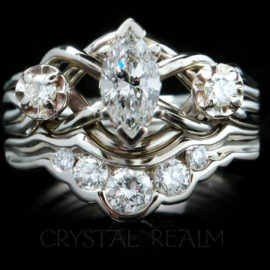 Three diamond engagement puzzle ring with five-diamond shadow band