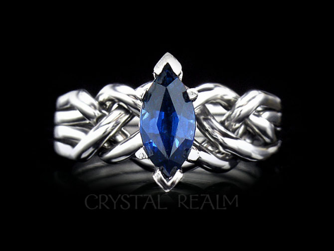 Marquise sapphire four band puzzle ring
