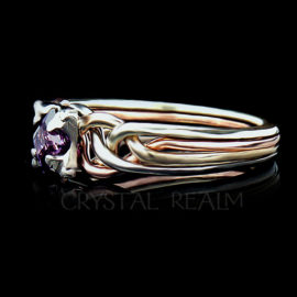 Guinevere puzzle ring with tight weave and four colors of 14k gold