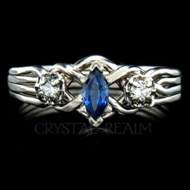 4 piece puzzle engagement ring with marquise sapphire and two round diamonds