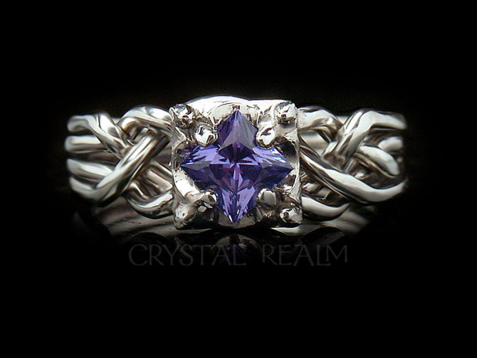 Guinevere four piece puzzle ring with princess cut tanzanite