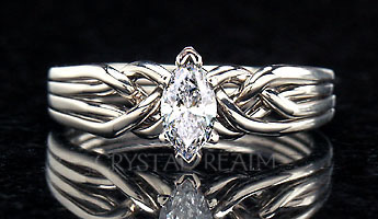 Four band marquise diamond puzzle ring with tight weave