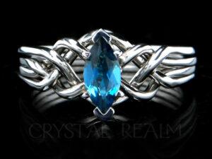 Marquise blue topaz engagement puzzle ring in platinum