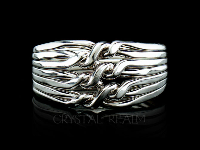 Seven piece chain puzzle ring in sterling silver and medium weight