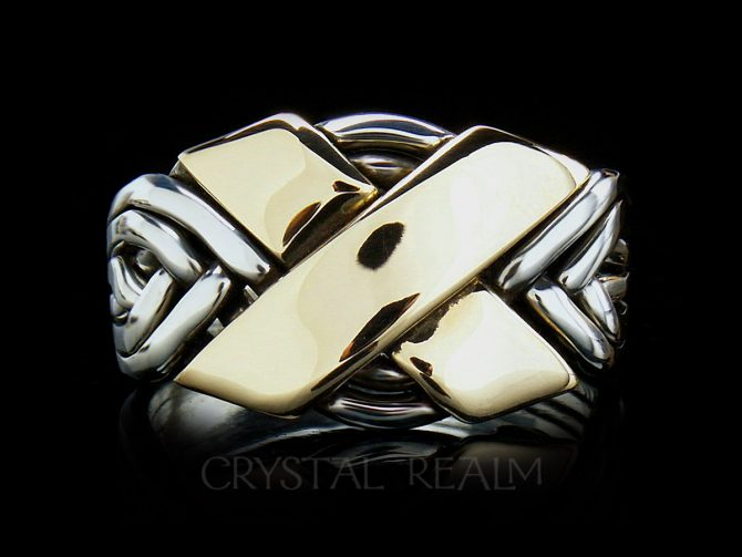 6 piece puzzle ring in sterling silver with two 14k yellow gold bars forming the 'x'