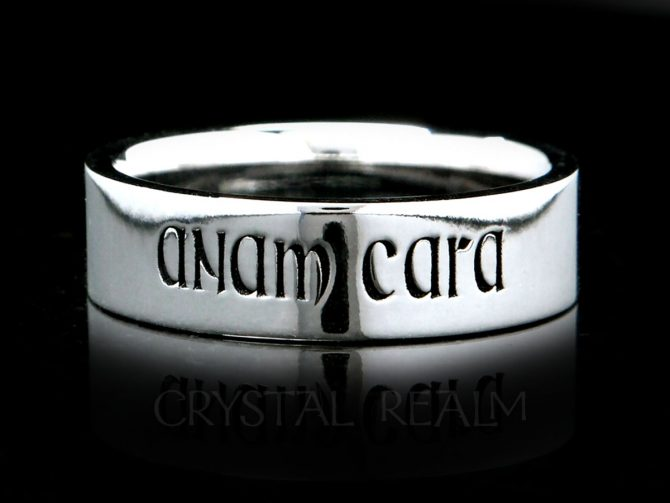 """A 14K white gold posy ring is inscribed with the words, 'anam cara,"""" meaning soul friend, in a Gaelic medieval font"""