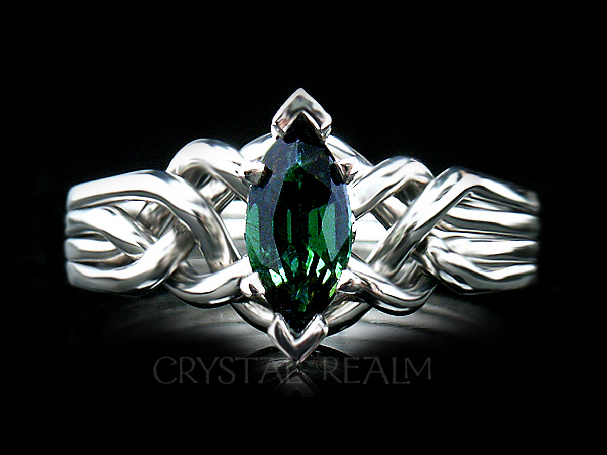 4 piece puzzle engagement ring with marquise tsavorite garnet