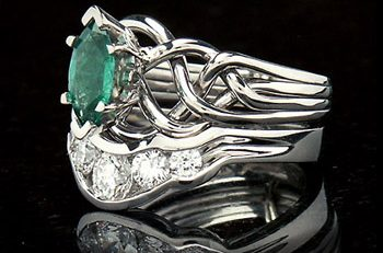 four band puzzle ring with marquise emerald and five diamond wedding ring