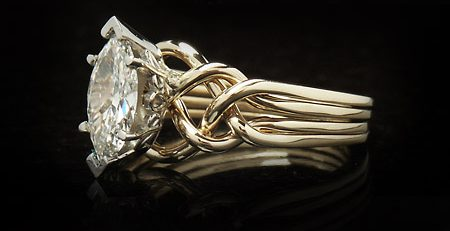 handwoven four piece puzzle ring with one carat marquise diamond
