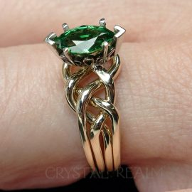One carat 4 piece puzzle ring in medium-heavy 14k yellow gold and 1ct marquise tsavorite green garnet