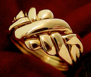 Men's heavy cast four-band puzzle ring in 14K yellow gold