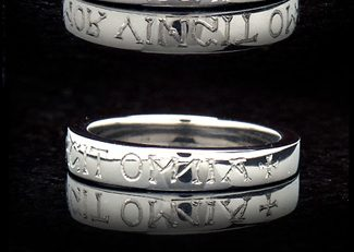 "Tapered ""Amor Vincit Omnia"" poesy ring"