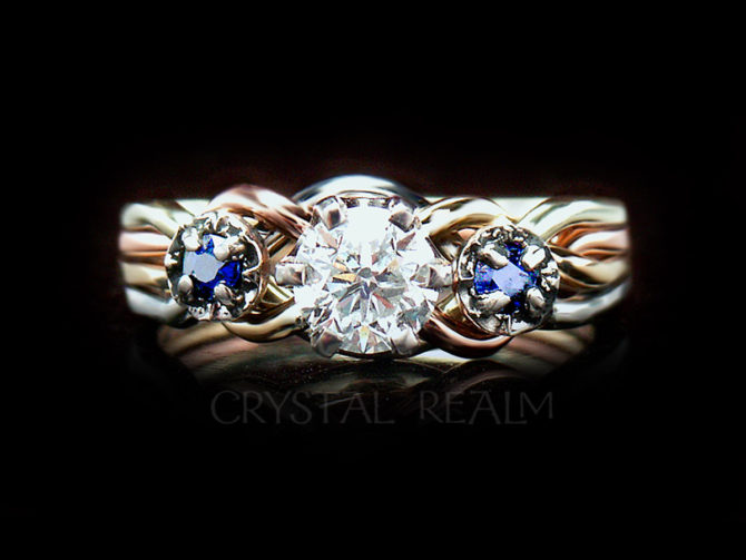 Four color 4 piece puzzle ring with half carat round diamond and side sapphires