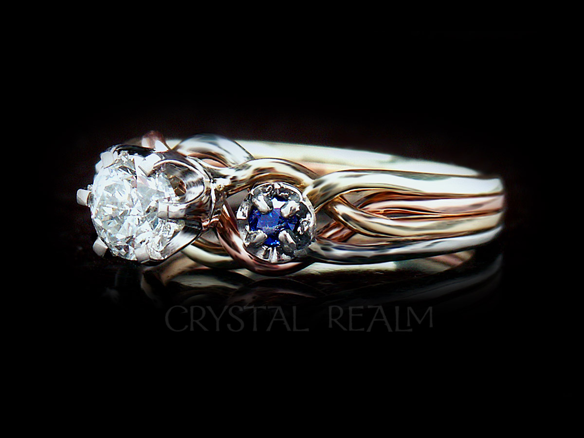 Athena puzzle engagement ring in four colors 14k gold and center one half round carat diamond accented by two round blue sapphires