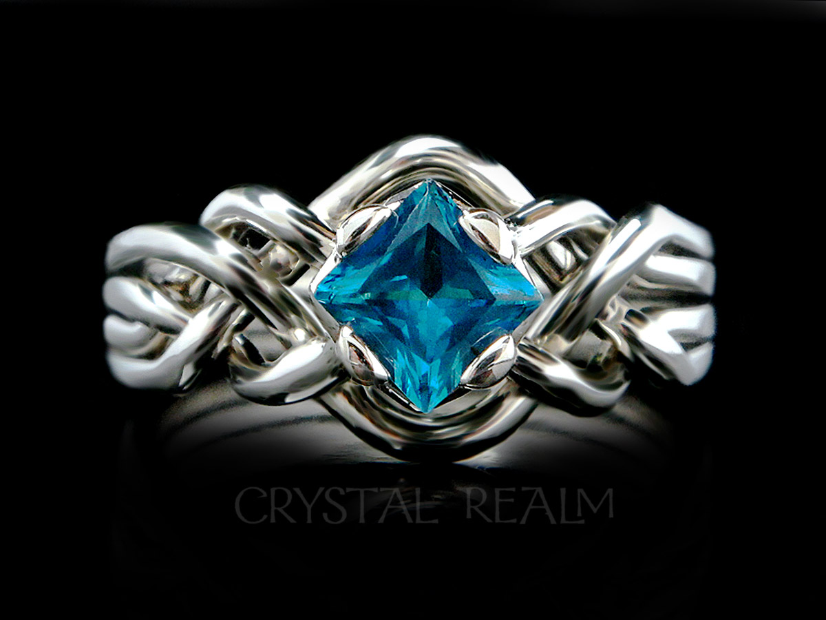 Avalon puzzle ring with 5mm Swiss blue topaz and open weave