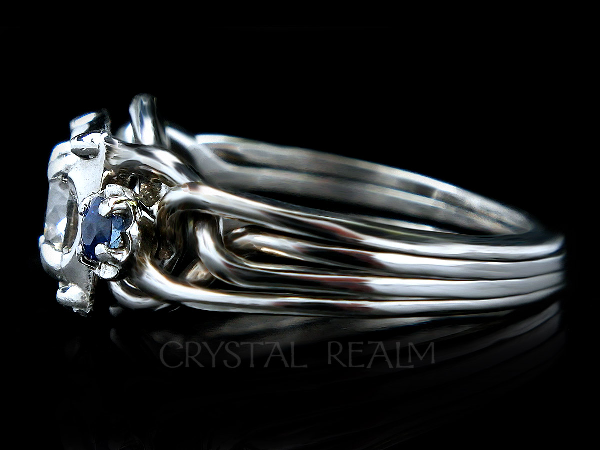 Side view 4 band puzzle ring with round diamond and side sapphires