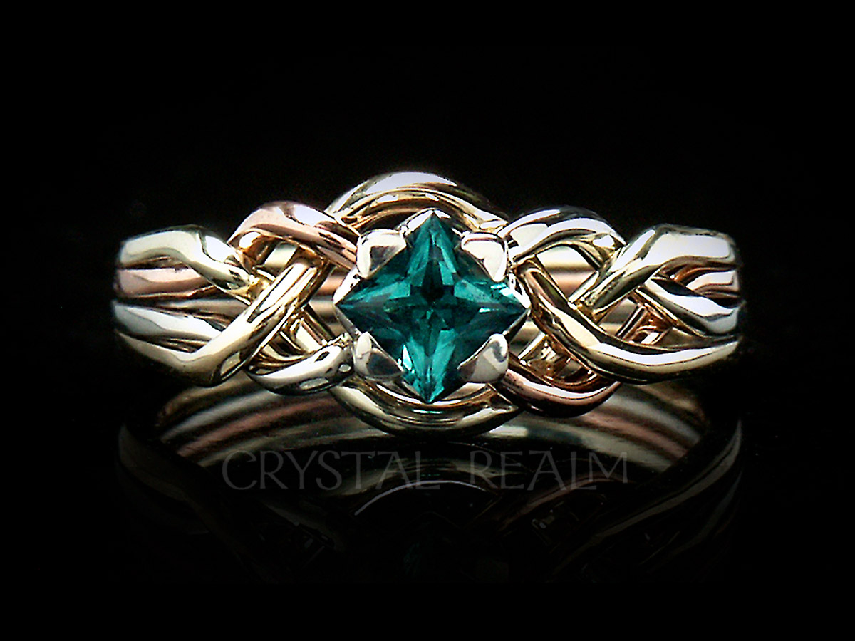 4 piece puzzle ring with princess cut lab created emerald and four colors of 14k gold