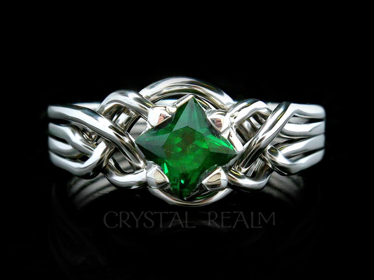 Guinevere puzzle engagement ring with princess cut tsavorite green garnet and palladium