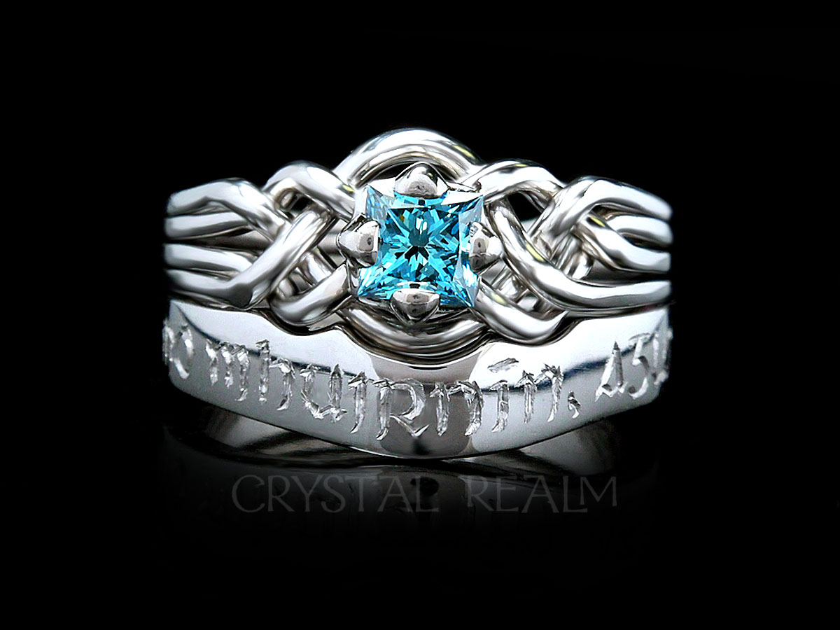 4 piece puzzle ring with blue diamond and hand-engraved wedding ring