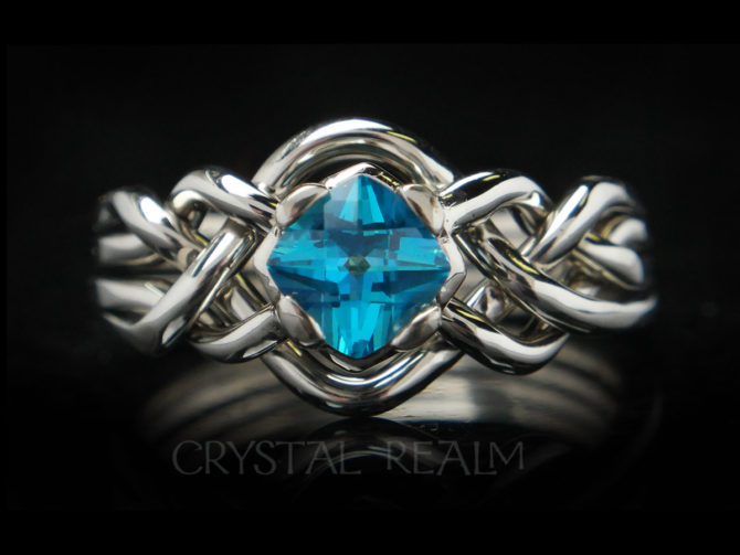 four piece puzzle ring with blue topaz and open weave