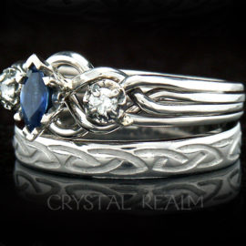 Four band puzzle ring with center sapphire, accent diamonds, and Celtic knot wedding ring