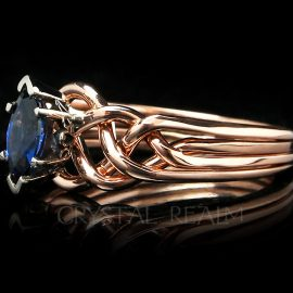 Marquise sapphire puzzle ring with four bands of 14k rose gold